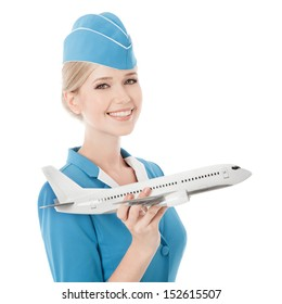 Charming Stewardess Holding Airplane In Hand. Isolated On White Background.