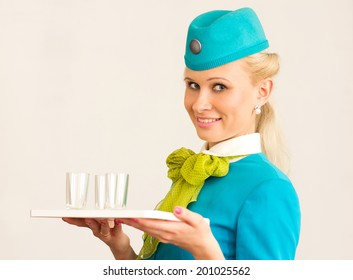 Charming Stewardess Holding tray with glasses In Hand.