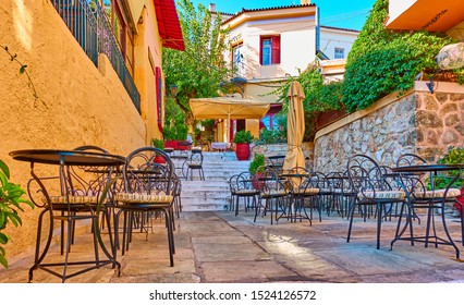 Charming street cafe in Plaka district in Athens, Greece