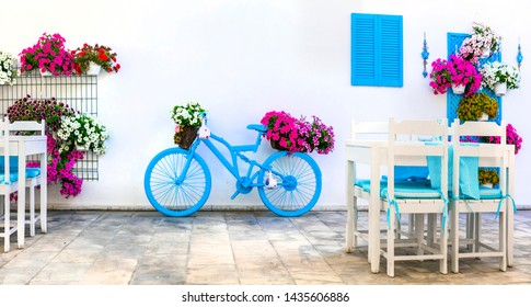 Charming street (outdoor) decoration with old bicycle and flowers in bar. Bodrum,Turkey