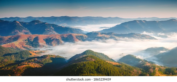 Charming summer scene of a misty valley from a bird's eye view. Location place of Carpathian mountains, Ukraine, Europe. Vibrant photo wallpaper. Nature photography. Discover the beauty of earth.