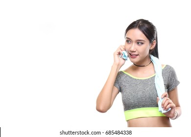 Charming tan skin Asian woman with exercise suit hand hold pure water bottle isolated on white background, Presenting fitness and good healthy concept.