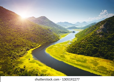 The charming valley of the Rijeka Crnojevica on a sunny day. Location place National park Skadar Lake, Montenegro, Balkans, Europe. Scenic image of the summer season. Explore the beauty of earth.