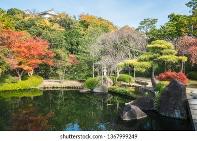 Charming view  from the stone bridge of a corner of Koko-en Garden, an Edo Style classical Japanese garden in Himeji,  right next to the famous castle, in autumn in Japan.