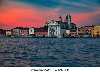 A charming view of Venice's waterfront with palaces and houses in the winter sunset