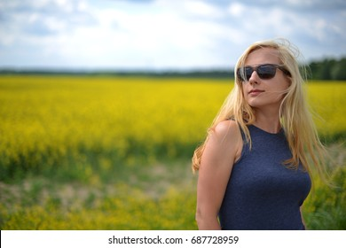 Charming woman at  field of canola