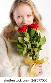 Charming woman holding nice bouquet of red roses on white background