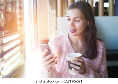 Charming woman with phone in cafe