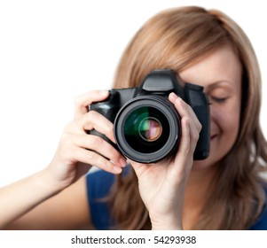 Charming woman using a camera against a white background