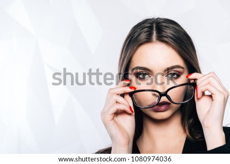 69858b48f676 A charming woman wearing stylish glasses. Fashion Style.Problems with vision
