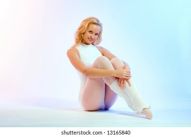 The charming young blonde during employment by fitness