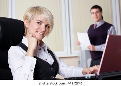 The charming young business woman in office