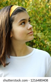 Charming young girl looking up