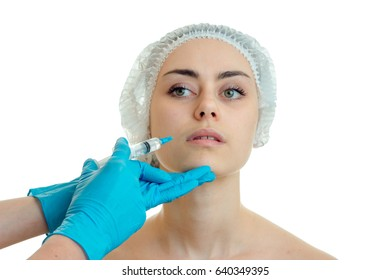 Charming young girl with make up at plastic surgeon