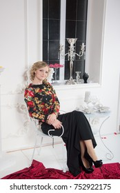 Charming young girl on a studio photo shoot
