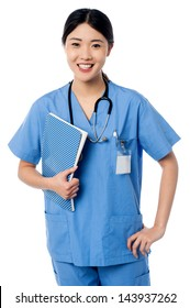 Charming young lady doctor posing with notebook