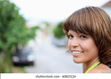 charming young woman on the street