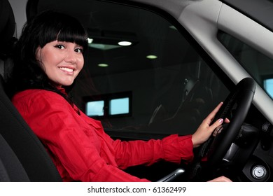 charming young woman sitting in a car