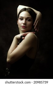 charming young woman, studio dark