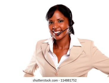 Charming young woman wearing a headset and smiling at you against white background