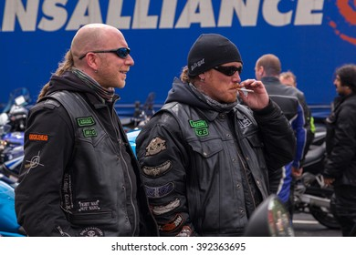 CHARNOCK RICHARD SERVICES, LANCASHIRE, ENGLAND - JUNE 24, 2012: Two men in motorcycle gear and sunglasses stood in front of a lorry siding at the North West Euro Demo Run. One of the men is smoking.