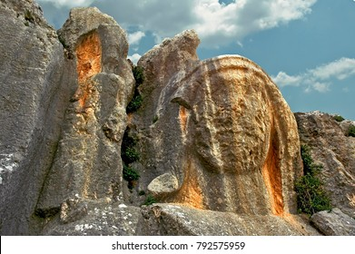 """The Charoinon of the Hell is located at the North of """"Cave Church of St. Pierre"""" about 200 m) and is an ancient carved stone bust in the mountainside above Antakya."""