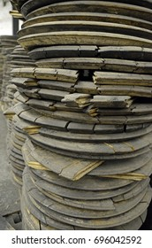 Charred oak barrel heads stacked after bring used to age bourbon, staged for another creative use.