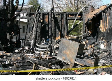 The charred ruin and remains of a burned down house