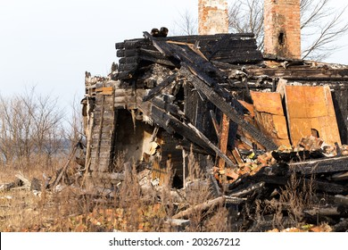 The charred ruins and remains of a burned down house