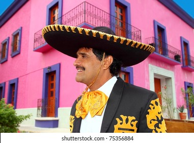 Charro mexican Mariachi portrait in pink Mexico house