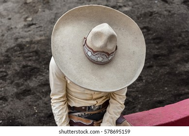 charro whit sombrero in the arena, view from above