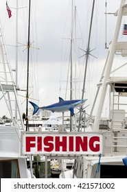 Charter Fishing sign with a shark in a marina