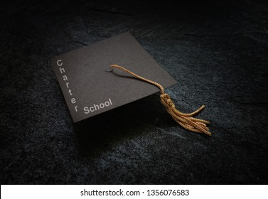 Charter School text on a graduation cap, on dark background