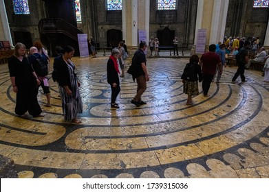 Chartres, France - July 2019: Worshippers walk the maze on the floor of the cathedral of Our Lady of Chartres