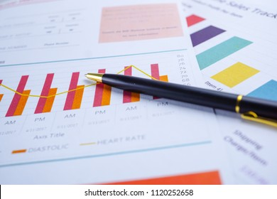 Charts Graphs paper and pen. Financial development, Banking Account, Statistics, Investment Analytic research data economy, Stock exchange trading, Business office company meeting concept.