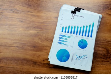 Charts,document and graphs are placed on the desks.