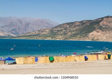 CHARVAK, UZBEKISTAN - AUGUST 22, 2015: Swimming pool by the Charvak lake in Northern Uzbekistan. Central Asia. Charvak lake by the foot of Tian Shan mountains is a popular gateway from Tashkent.