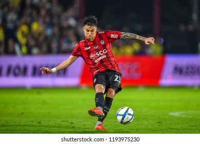 Charyl Chappuis N0.23 (red) of Muangthong United in action during Football Thai League 2018 match between SCG Muangthong United and Burirum United at SCG Stadium 16August 2018 Nonthaburi ,Thailand.