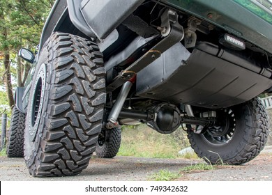 Chassis off road vehicle in the parking lot. The undercarriage of terrain car on way in nature.