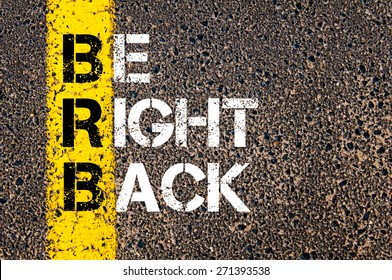 Chat Acronym BRB as Be Right Back. Yellow paint line on the road against asphalt background. Conceptual image