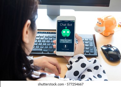 chat bot concept.Young Female hands holding mobile phone