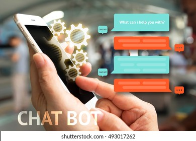 Chat bot and future marketing concept , Chatbot icon , Hand holding mobile phone and gear popup out mobile screen with automatic message screen with abstract background