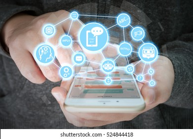 Chat bot and future marketing concept , chatbot connect icons with hand holding mobile phone.