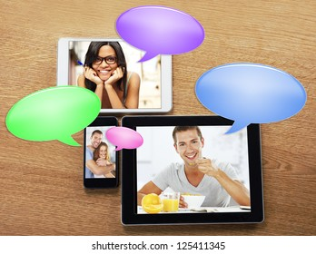 Chat. digital tablets and smart phone with images and bubbles chat icon. mobile phone and a tablets with photos on a desktop