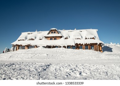Chata Maraton hut on Lysa hora hill in Moravskoslezske Beskydy mountains in Czech republic during freezing winter day with lot of snow and clear sky