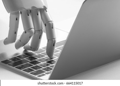Chatbot , artificial intelligence , robo advisor , robotic concept. Robot finger point to laptop button.