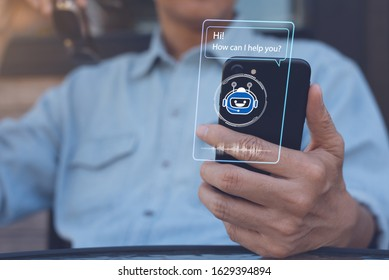 Chatbot assistant conversation, Ai Artificial Intelligence technology concept. Casual man relax chatting with chatbot via mobile smart phone application with speech bubble on virtual screen