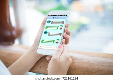Chatbot concept.Close-up of female hands holding mobile phone