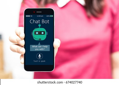 Chatbot.Female hands holding mobile phone,high key