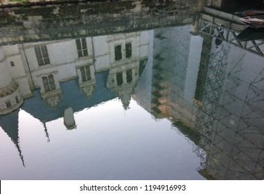 Chateau of Azay-le-Rideau, Loire Valley, France - December 29, 2016. Frosty winter day does not stop tourists from visiting the chateau. Water reflecting the chateau.